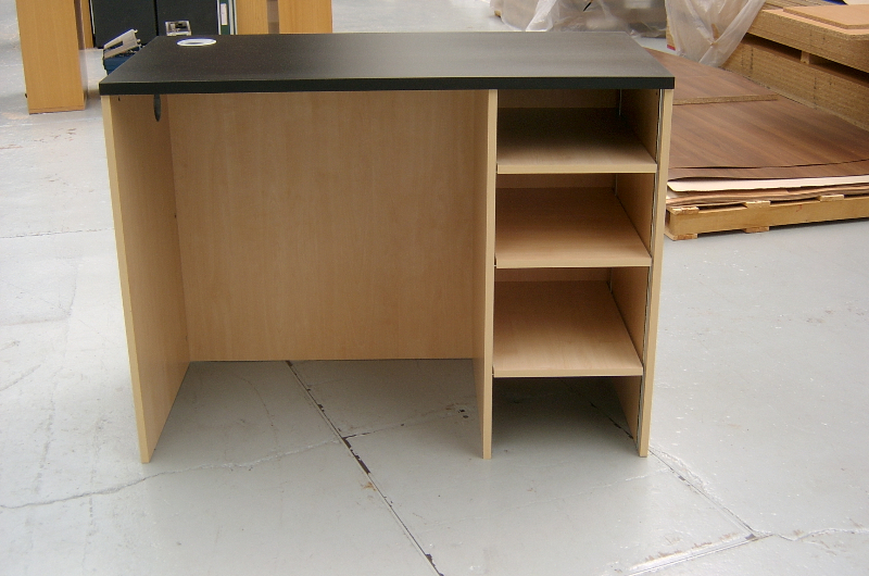 Image 66F/R - Rear of the Bespoke reception counter showing the built in shelving