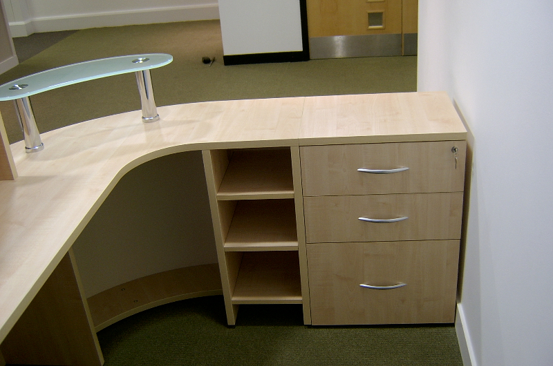 Compact 3 drawer desk high pedestal shown with a shelf unit