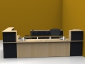 Image 12C Classic reception desk finished in Maple and Graphite Grey with a glass shelf to the front unit and storage behind.