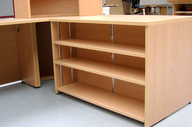Built in shelving to the rear of a DDA unit