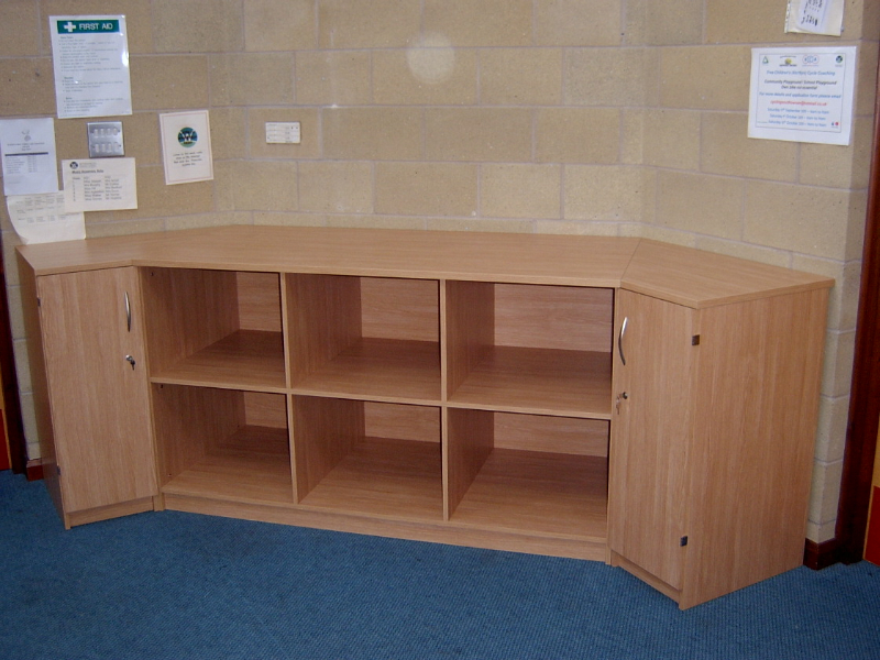 Bespoke box storage with side cupboards
